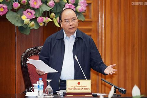 นายกรัฐมนตรีเป็นประธานการประชุมเกี่ยวกับมาตรการผลักดันการผลิตและประกอบธุรกิจ - ảnh 1