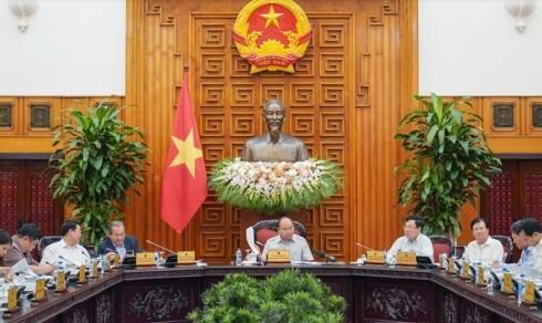 รัฐบาลประชุมเกี่ยวกับข้อกำหนดในการปฏิบัติโครงการ BT และประเมินการปฏิบัติกฎหมายการวางแผน - ảnh 1