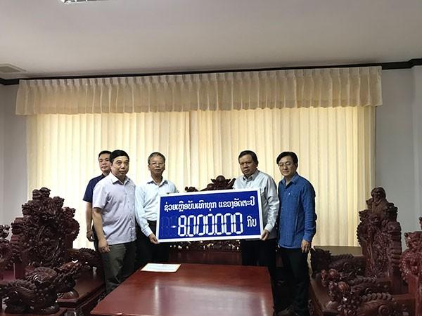 Người Việt tại Trung Lào ủng hộ người dân do sự cố vỡ đập thủy điện - ảnh 1