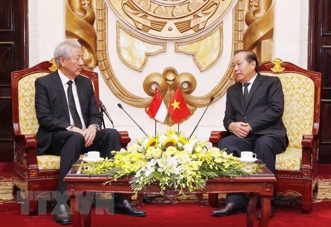 Phó Thủ tướng Thường trực Trương Hòa Bình tiếp Phó Thủ tướng Singapore  - ảnh 1