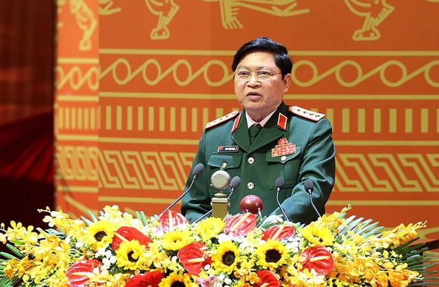 Bộ trưởng Quốc phòng Ngô Xuân Lịch tiếp xúc song phương với Bộ trưởng Quốc phòng CHDCND Lào - ảnh 1
