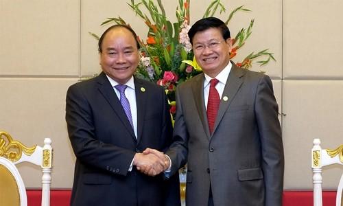 Thủ tướng Chính phủ Nguyễn Xuân Phúc hội đàm với Thủ tướng Thái Lan và Thủ tướng Lào - ảnh 2