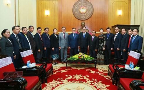 Việt Nam và Lào tăng cường hợp tác về công tác Mặt trận - ảnh 1