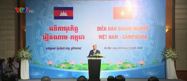 Thủ tướng Việt Nam và Campuchia dự Diễn đàn doanh nghiệp hai nước - ảnh 1