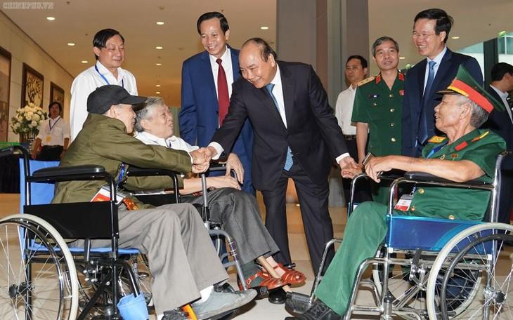 Thủ tướng dự lễ tuyên dương thương binh nặng tiêu biểu toàn quốc - ảnh 1