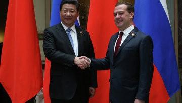 Председатель КНР Си Цзиньпин провёл переговоры с премьер-министром РФ - ảnh 1