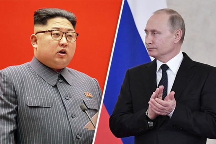 Путин пригласил лидера КНДР Ким Чен Ына посетить Россию в сентябре  - ảnh 1