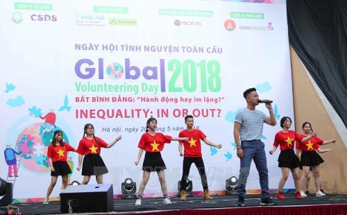 2018年全球志愿者日在河内举行 - ảnh 1