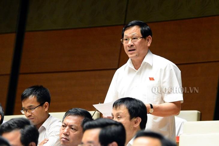 越南国会讨论《饲养法(草案)》和《人民公安法修正案(草案)》 - ảnh 1