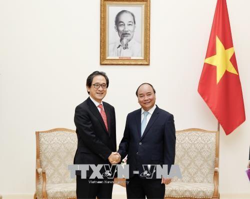 阮春福会见日本贸易振兴机构理事长石毛博行 - ảnh 1
