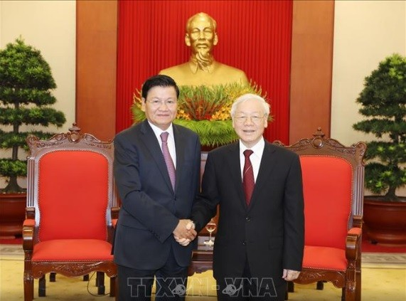 越共中央总书记阮富仲会见老挝总理通伦 - ảnh 1