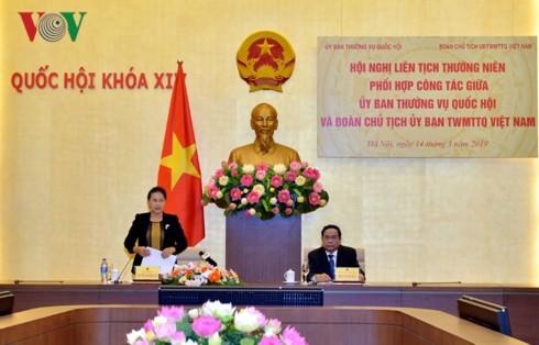 越南国会常务委员会与祖国阵线中央委员会主席团工作协调配合机制会议举行 - ảnh 1