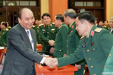阮春福强调将发展经济与保障国防安全相结合的精神 - ảnh 1
