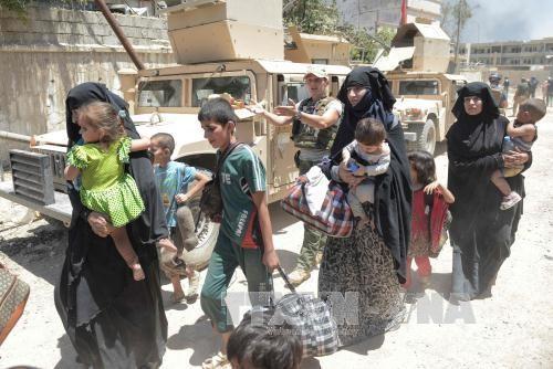 កងកម្លាំងសន្តិសុខអ៊ីរ៉ាក់បើកផ្លូវរត់គេចខ្លួនសំរាប់ជនស៊ីវិលនៅ Mosul - ảnh 1