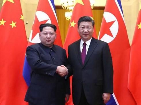 ថ្នាក់ដឹកនាំកូរ៉េខាងជើងលោក Kim Jong-un បំពេញទស្សនកិច្ចនៅចិន - ảnh 1