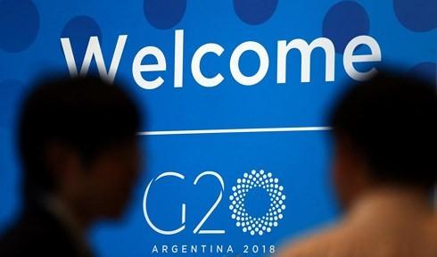 ក្រុម G20 អំពាវនាវឱ្យមានការបង្កើនកិច្ចសន្ទនាស្តីពីភាពតានតឹងពាណិជ្ជកម្ម - ảnh 1