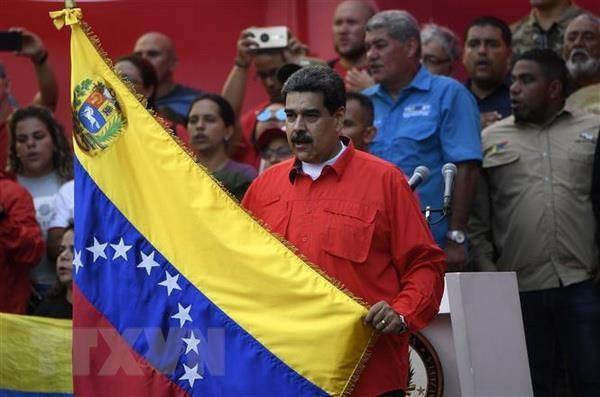 ប្រធានាធិបតីវ៉េណេស៊ុយអេឡា លោក  Nicolas Maduro បានអំពាវនាវឱ្យកងកម្លាំងប្រដាប់អាវុធរួបរួមគ្នាដើម្បីការពារប្រទេសជាតិ - ảnh 1
