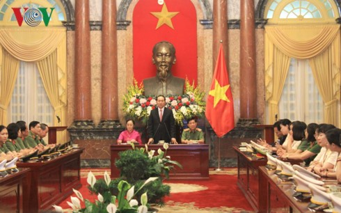 Chủ tịch nước Trần Đại Quang gặp mặt Phụ nữ Công an tiêu biểu năm 2016 - ảnh 1