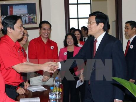 ประธานประเทศแลกเปลี่ยนข้อราชการกับสภากาชาดส่วนกลางเวียดนาม - ảnh 1