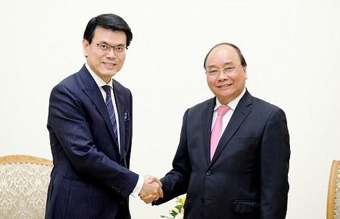 นายกรัฐมนตรี เหงวียนซวนฟุก ให้การต้อนรับอธิบดีกรมพัฒนาการค้าและเศรษฐกิจฮ่องกง ประเทศจีน  - ảnh 1
