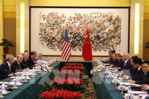 จีนเตือนว่า การปรับเพิ่มภาษีของสหรัฐจะทำลายข้อตกลงการค้าที่ได้บรรลุ - ảnh 1