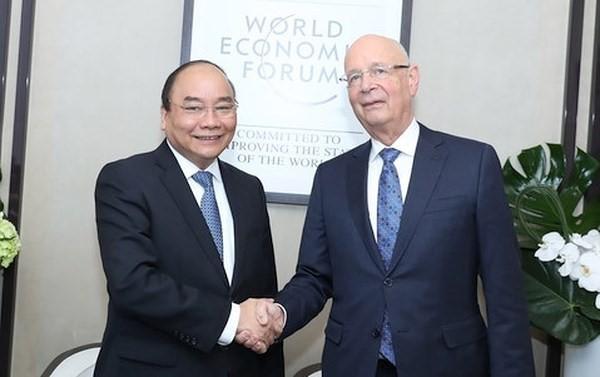 นายกรัฐมนตรีเวียดนามให้การต้อนรับผู้ก่อตั้งและประธานฝ่ายบริหาร WEF - ảnh 1