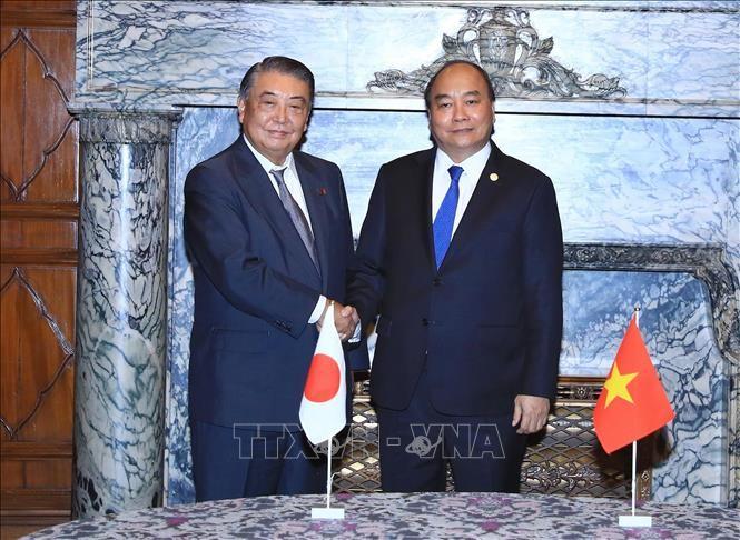 นายกรัฐมนตรีเวียดนามพบปะกับผู้นำรัฐสภาญี่ปุ่น - ảnh 1