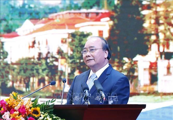 นายกรัฐมนตรี เหงวียนซวนฟุกเข้าร่วมการประชุมส่งเสริมการลงทุนจังหวัดลาวกาย - ảnh 1