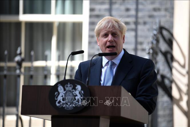 นายกรัฐมนตรีอังกฤษเรียกร้องให้อียูทำความเข้าใจร่วมเกี่ยวกับแผนกั้นหลัง - ảnh 1