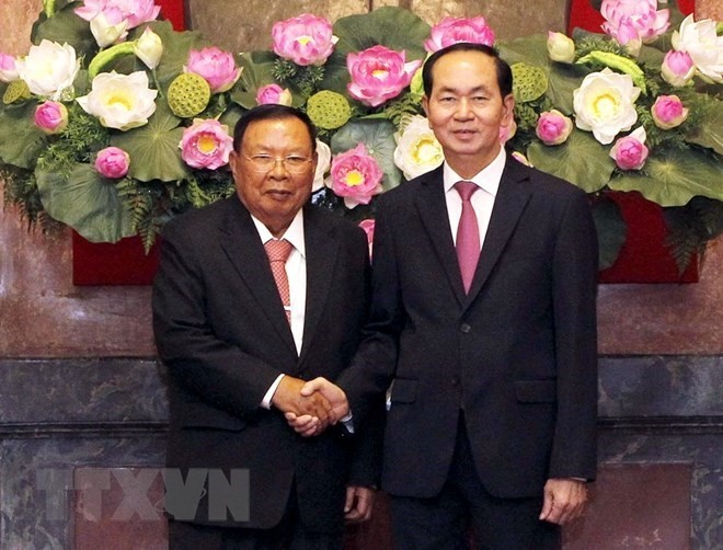 Top Lao leader pays five-day visit to Vietnam - ảnh 2