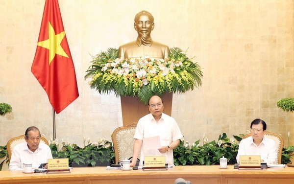 PM Nguyen Xuan Phuc asks for greater focus on building institutions - ảnh 1