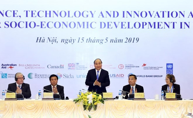 Prime Minister attends science, technology, innovation meeting - ảnh 1