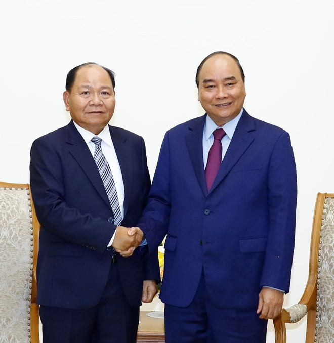 Prime Minister hosts Lao Minister of Home Affairs - ảnh 1
