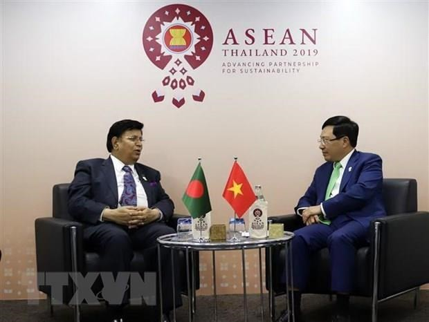 Deputy PM holds bilateral meetings on AMM-52 sidelines - ảnh 2