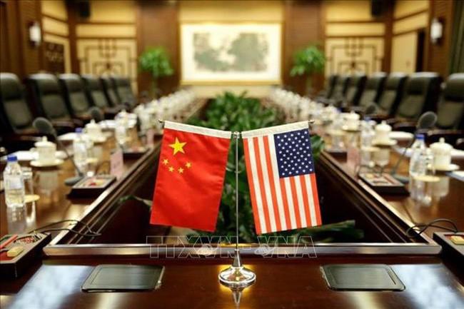 中美进行新一轮贸易谈判 - ảnh 1