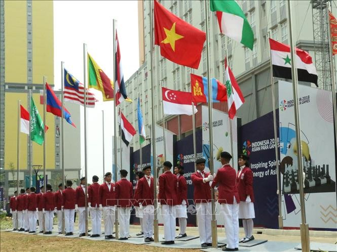 Flag-raising ceremony held for Vietnam at Asian Para Games 2018 - ảnh 1