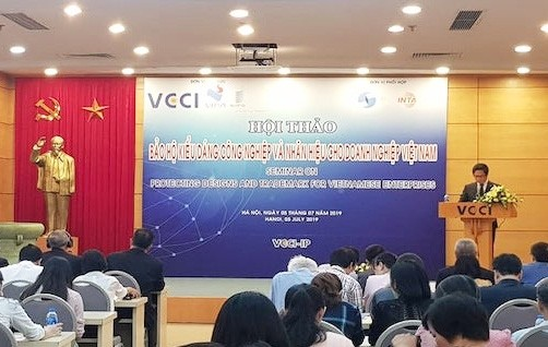 Seminar discusses protecting Intellectual Property rights of  businesses - ảnh 1