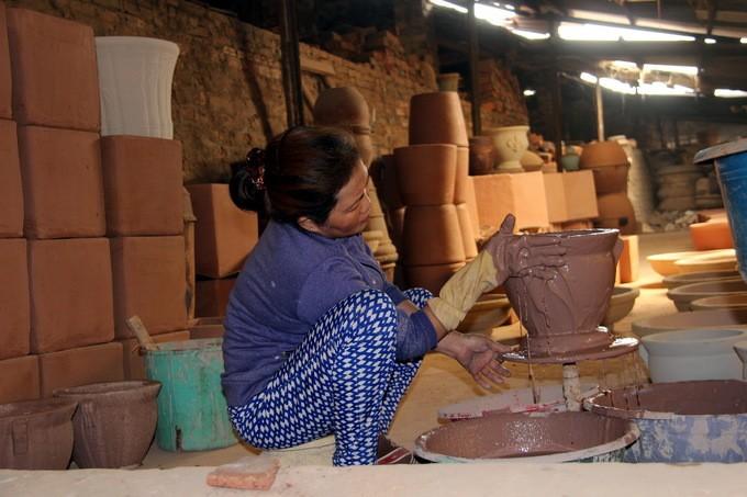 Inagotable vitalidad de una aldea dedicada al oficio tradicional de la cerámica - ảnh 2