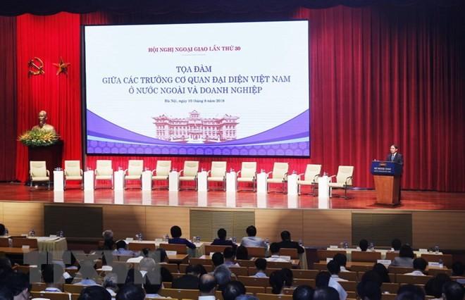 Favorecen más a las empresas vietnamitas en su integración internacional  - ảnh 1
