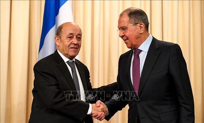 Rusia y Francia acuerdan continuar esfuerzos por mantener el acuerdo nuclear iraní  - ảnh 1