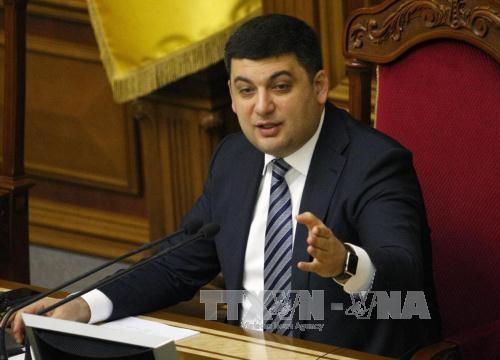 ยูเครนผลักดันการจัดตั้งรัฐบาลร่วมชุดใหม่ - ảnh 1