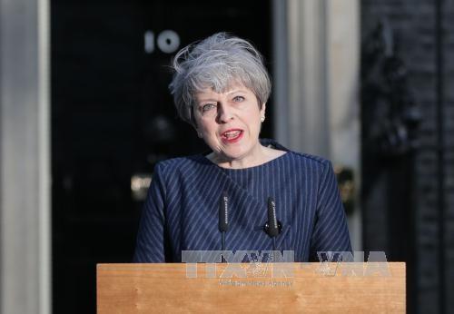 นายกรัฐมนตรีอังกฤษเรียกร้องให้จัดการเลือกตั้งทั่วไปในวันที่ 8 มิถุนายนนี้ - ảnh 1
