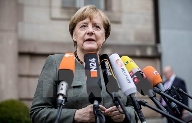 นายกรัฐมนตรีเยอรมนีประกาศว่า จะไม่ลาออกจากตำแหน่งและเตรียมพร้อมให้แก่การเลือกตั้งใหม่ - ảnh 1