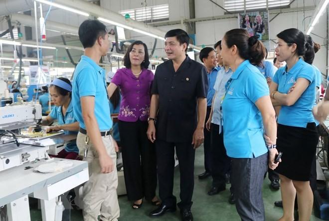ฉลองวันแรงงานสากล 1 พฤษภาคม: สหภาพแรงงานเวียดนามคือที่พึ่งที่มั่นคงของแรงงาน - ảnh 1