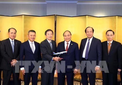 นายกรัฐมนตรีให้การต้อนรับผู้ประกอบการนอกรอบการประชุมสุดยอดแม่น้ำโขง-ญี่ปุ่นและเยือนญี่ปุ่น - ảnh 1