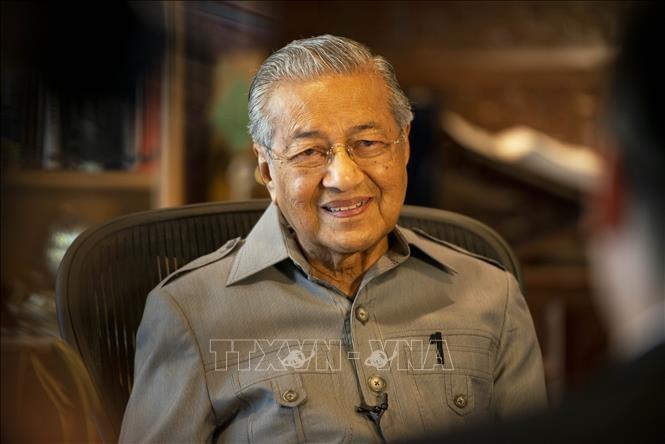 นายกรัฐมนตรีมาเลเซีย มหาเธร์ โมฮัมหมัด ให้ความสำคัญต่อความร่วมมือระหว่างสถานประกอบการมาเลเซียกับเวียดนาม - ảnh 1