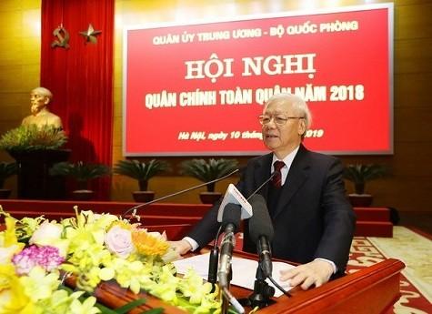 เลขาธิการใหญ่พรรค ประธานประเทศ เหงียนฟู้จ่อง เข้าร่วมการประชุมกองทัพปี 2018 - ảnh 1
