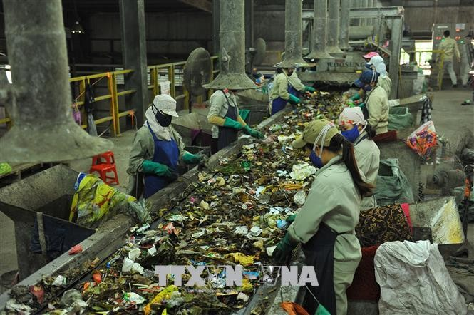Seminar discusses urban solid waste management - ảnh 1
