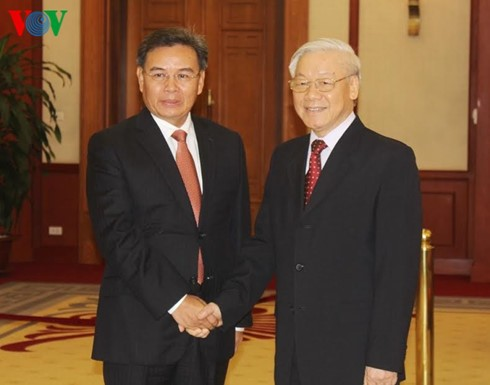 KPV-Generalsekretär Nguyen Phu Trong empfängt hochrangige Delegation aus Laos - ảnh 1