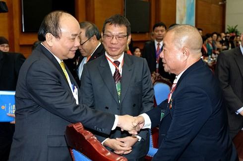 Hochrangige Politiker treffen mit Auslandsvietnamesen zum Neujahrsfest - ảnh 1